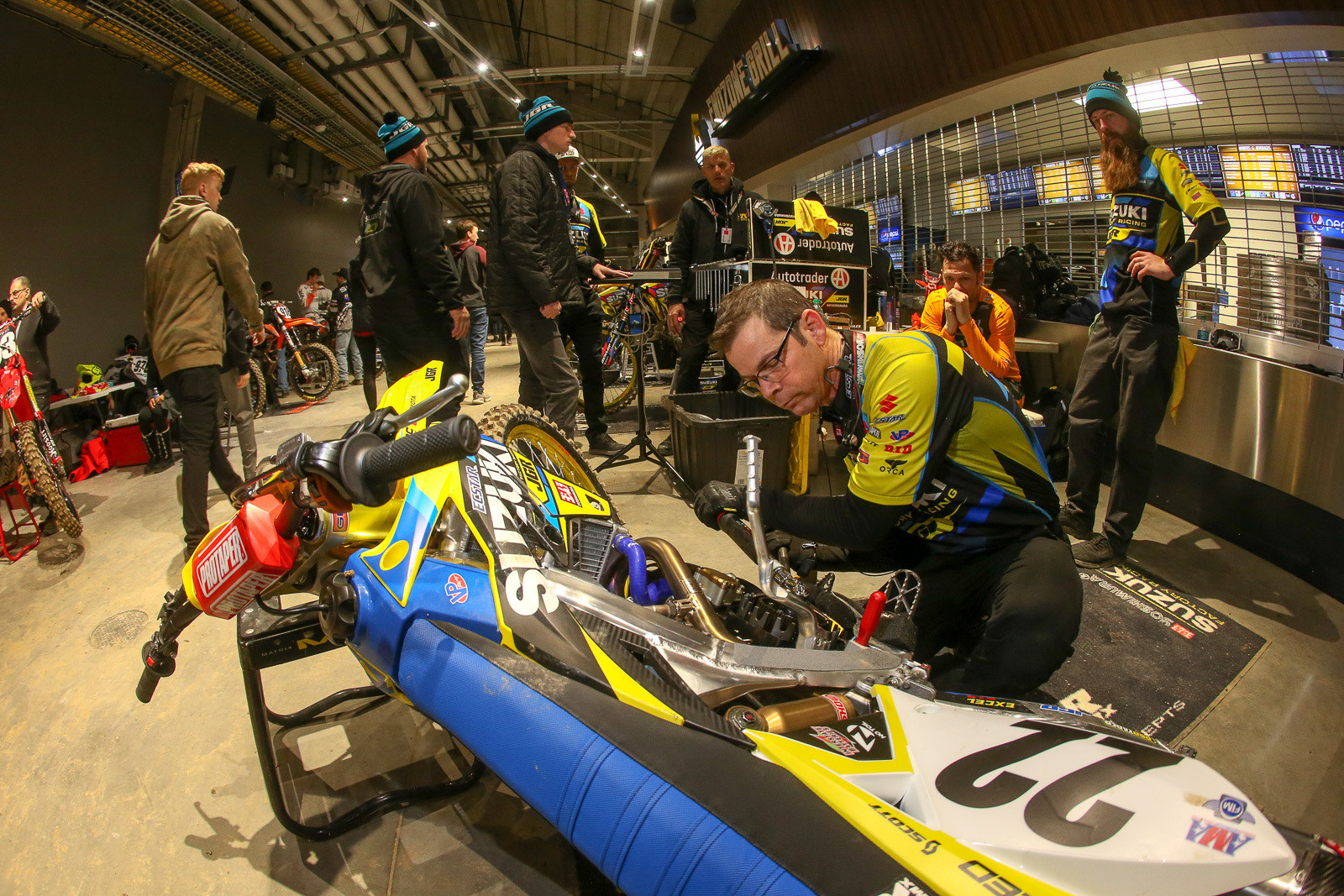With the extreme cold outside (it was -9 early Saturday morning), all the teams opted to move inside to pit. Here, Dean Baker does a quick clutch swap on Chad Reed's Suzuki after the untimed practice.