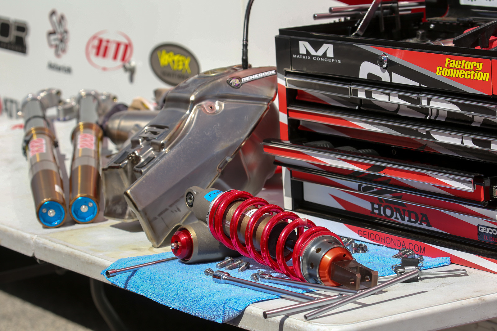 We love seeing a workbench scattered with trick goodies, like over at the GEICO Honda truck.