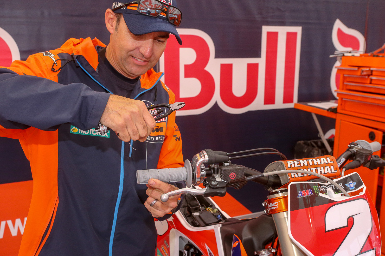 Cooper Webb likes to make sure his grips are super-secure, so Carlos Rivera adds and extra round of safety wire.