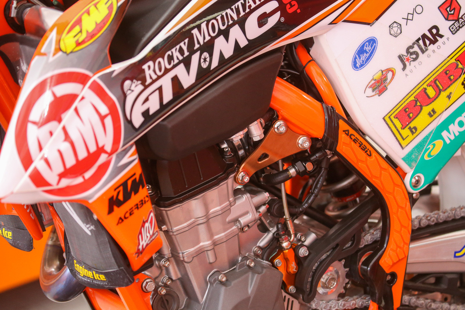This year maybe more than any time in recent memory, we've seen people experimenting with different motor mounts. We spotted these new bits on the Rocky Mountain ATV-MC/KTM/WPS bikes. Did it have anything to do with Blake Baggett's first moto win? Who knows? But they do look good on there.