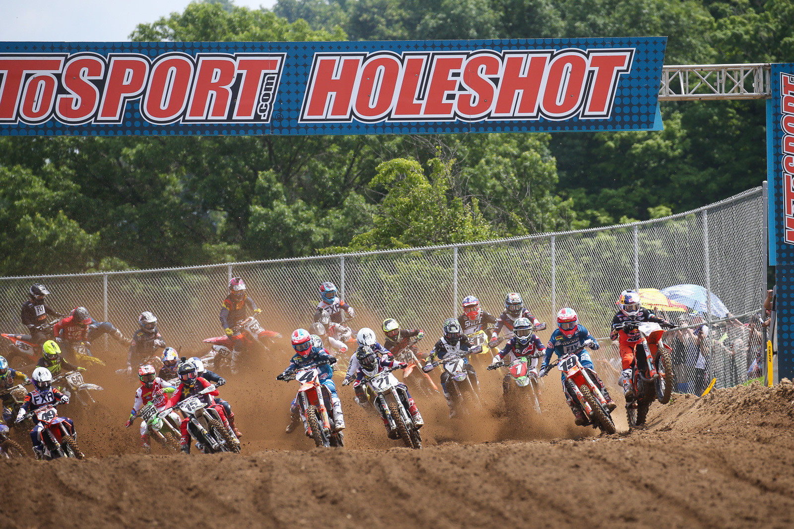 The start was in the same place as it was for the MXoN, rather than the traditional location. Chatting with Eli Tomac after the race, he said he actually prefers this version to the old one. The 450s ran first this week, and as the snarling pack of 450s exited the first turn, Cooper Webb was running up front. Check the bank that he's riding on. That's definitely living on the edge.