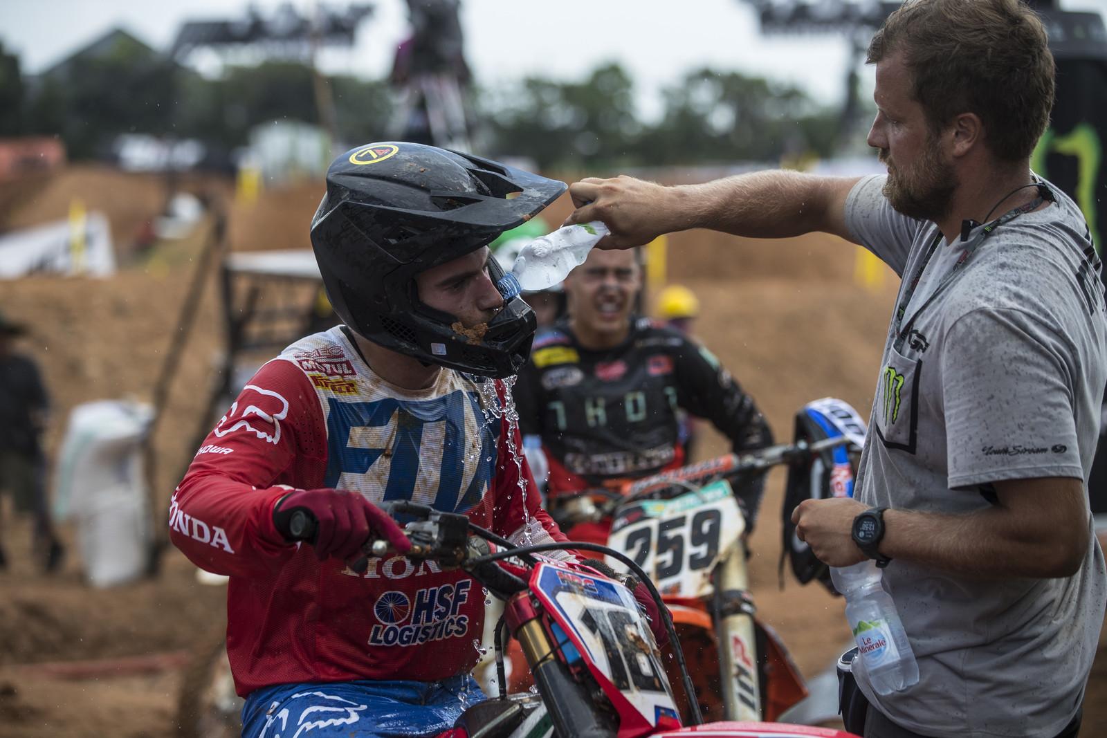 Honda HRC rider Brian Bogers gets a little hydration help.