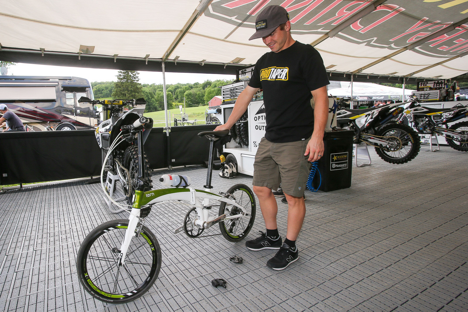 Zach Osborne has a cool little folding road bike that he can stash in the underside of his bus. That way he can get in rides when he gets to the track.