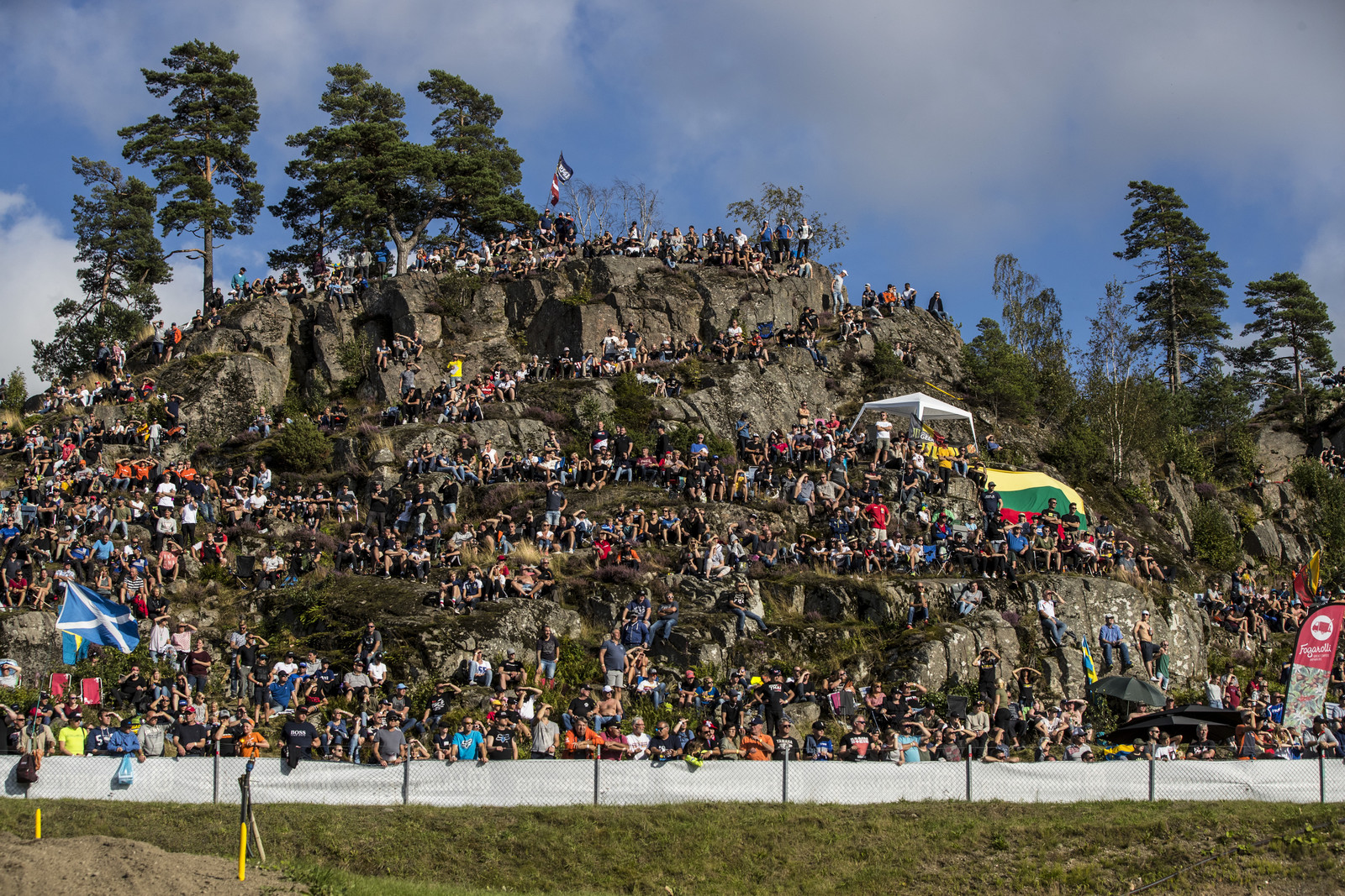The Swedish fans don't mind a little rock climbing to get the best seats.