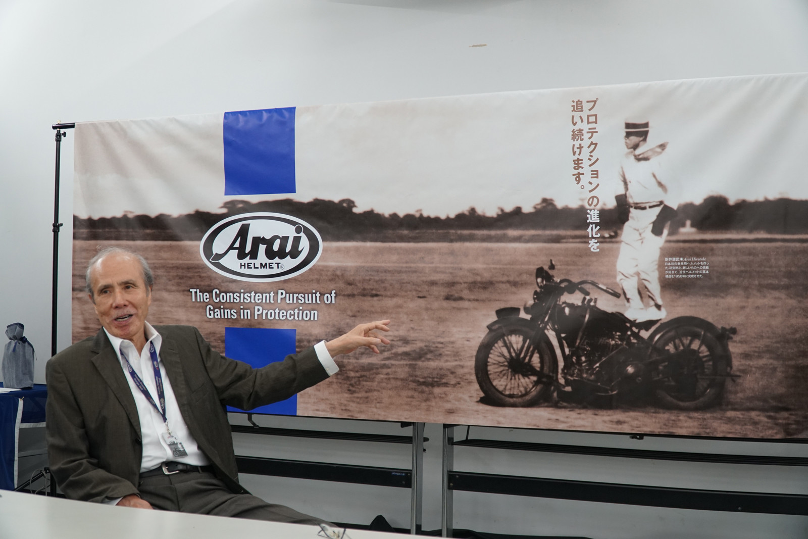 Mr. Arai is seated in front of an iconic poster featuring his father Hirotake Arai, who started the company. Aki Arai, Mr. Arai's son, also works at the company and is line to take it over when Mr. Arai retires.