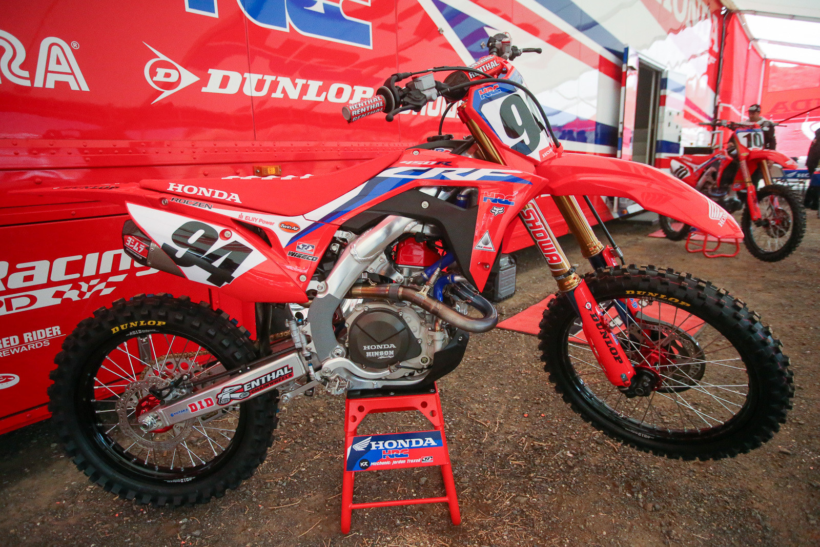 Here's a peek at the new look that the Team Honda HRC riders will be rocking in '20. We like the red valve cover. We're still getting used to the abbreviated background on the sideplates where the rider's boots usually very quickly chew up the stickers.