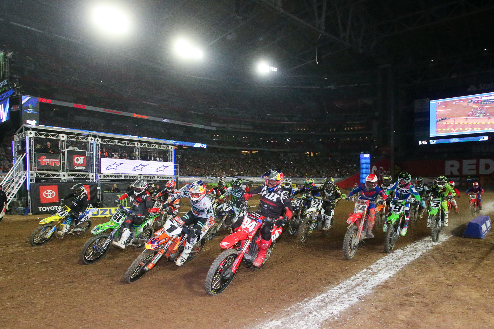 A whole healthy pack of riders head to the first turn in one of the Triple Crown main events in Glendale.