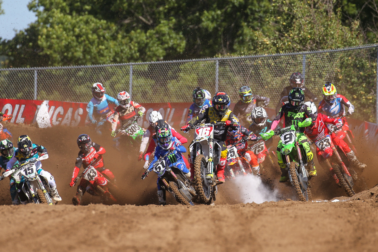 Zach Osborne kicks up some chalk as he leads the pack over the holeshot line.