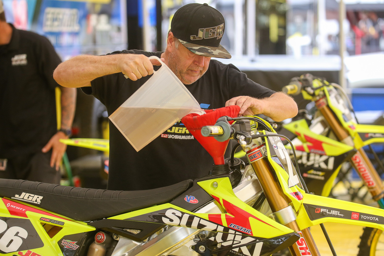 Lee Mccollum topping off Alex Martin's RM-Z250 with fuel. Only a limited number of 250s went for it on Larocco's Leap. This was one of them.