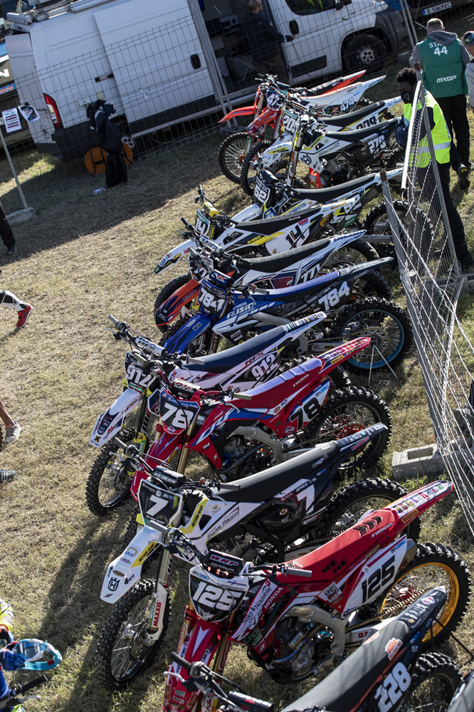 Bikes lined up for the MX2 class. Side plate backgrounds and numbers don't have to match the front, which has to be black with white numbers.