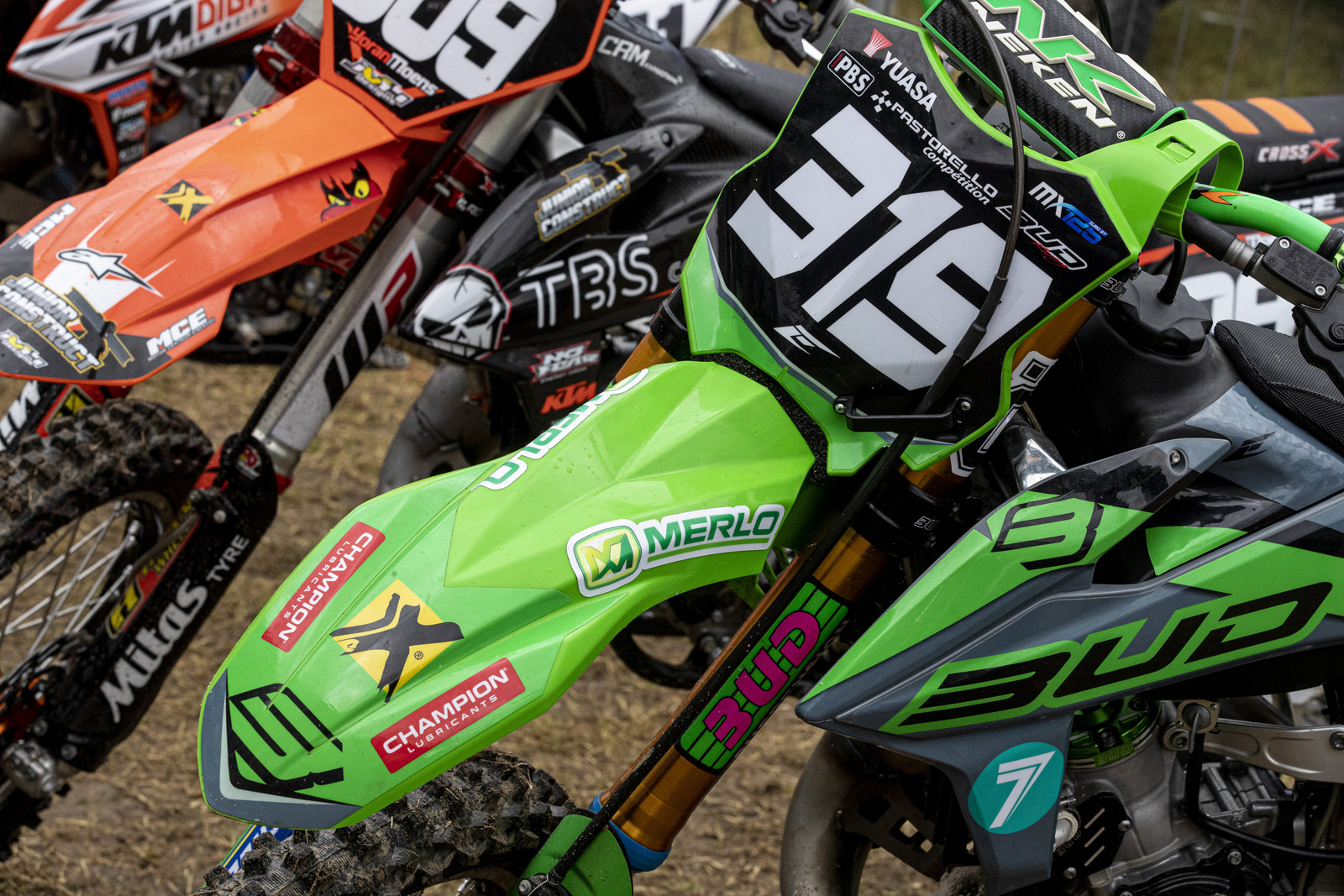We are going to start right in with some sweet bikes! At first glance, this bike is clearly a Kawasaki. That is definitely KX front plastics. But what about those shrouds...