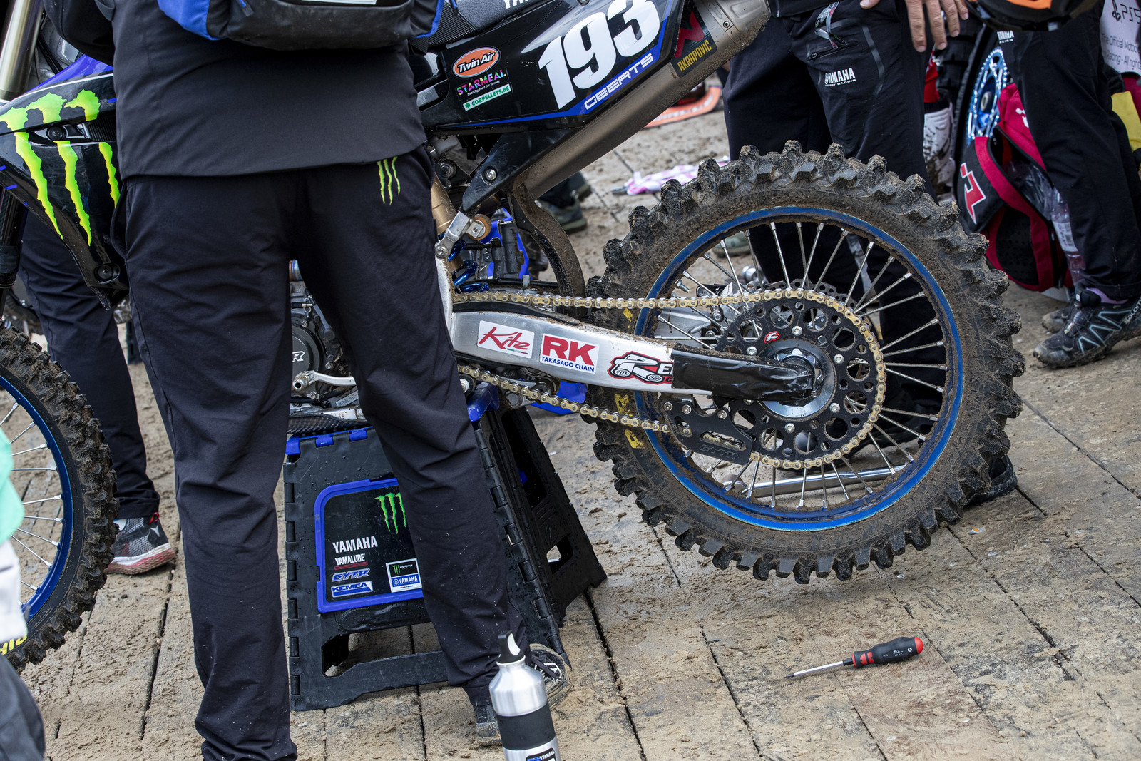 Duct tape on the swingarm? Makes for a cleaner wheel change after the sight lap. See photos below.