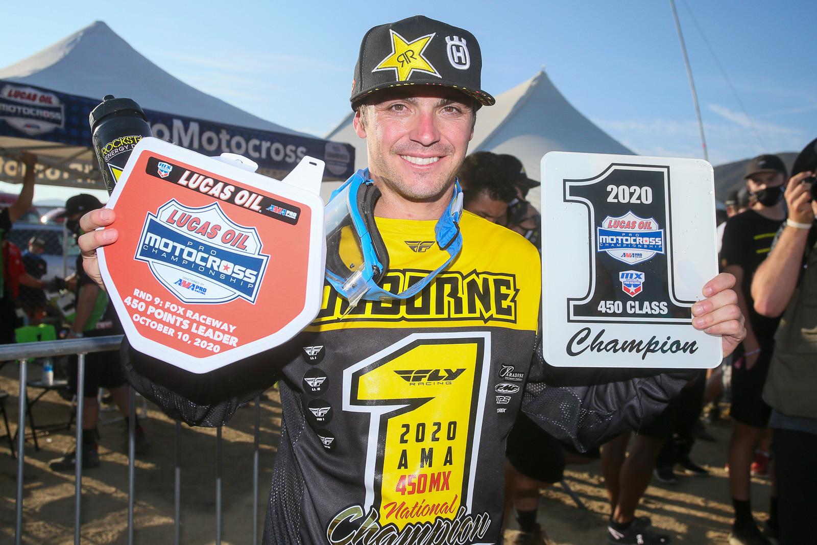 Zach Osborne with a few of the awards he scored for clinching the Lucas Oil Pro Motocross Championship 450 crown.