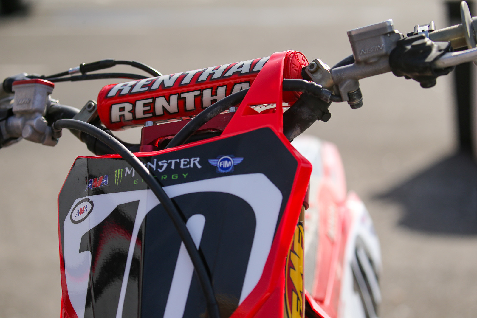 What else is different on JB's bike? To clean up the front of the bike for him, his mechanic, Brent, has routed the clutch line in front of the bars, rather than behind.