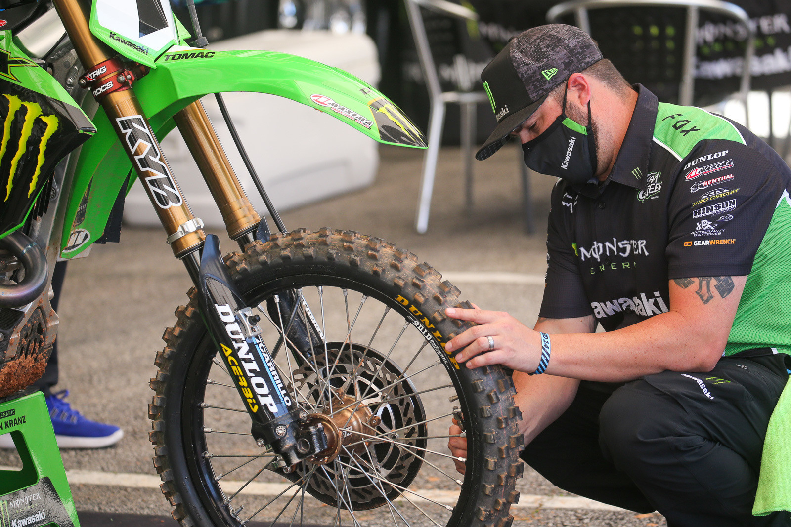 One spoke at a time (yep, with a spoke torque wrench), and one bolt at a time. Brian Kranz getting it done for Eli Tomac.