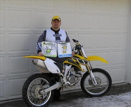 sponsor photo with Alaska State Mx vet champ and Anchorage City Vet number one plates for 2005