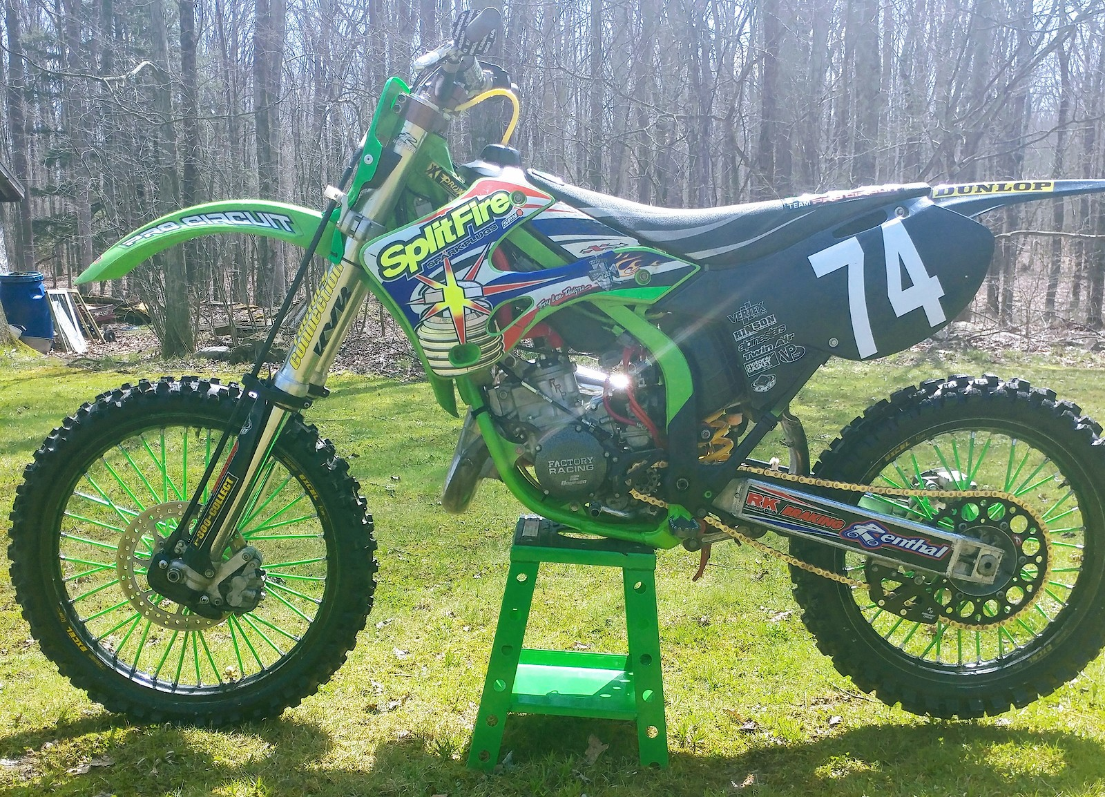 99 kx 125 splitfire replica  Ported and polished head done to a more rideable version of Charmichaels bike, runs on minimum 110 octane, work was done by RRP in new Jersey. Carb bored and jetted Factory connection suspension Pro circuit pipe and silencer Pro circuit linkage Pro circuit pegs Pro circuit top triple clamp Excel rims  Renthal twin wall bars Renthal sprockets Boyesen rad valve with new carbon fiber reeds Boyesen covers Boyesen water pump Pro x piston Pro x crank 6 hrs on full motor rebuild Mx bones carb hose kit  Radiator hose kit Primary drive chain guide New geo max mx 52 tires Every bearing is new Breaking brake disks Bike was in storage from 03 to 2017, taken out and totally rebuilt 3500. Located in Pennsylvania Original owner NO TRADES PLEASE.