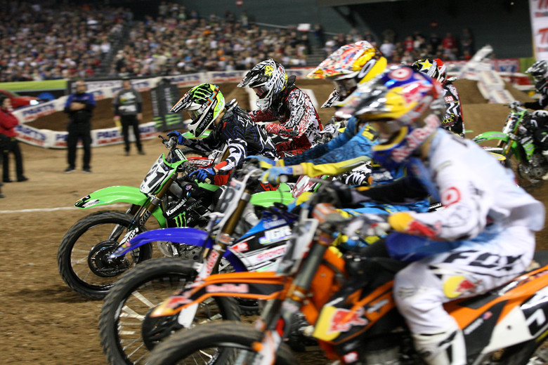 Jake Weimer rails around the outside to a good start, but Ryan Dungey is charging on the inside line, and grabbed the holeshot.